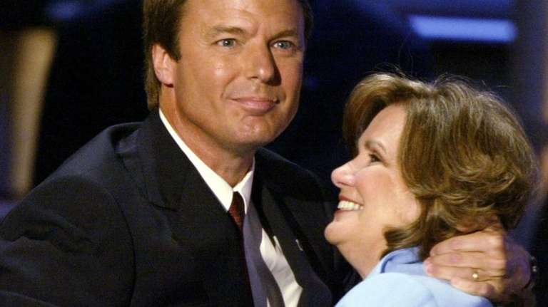 Democratic vice presidential candidate John Edwards hugs his
