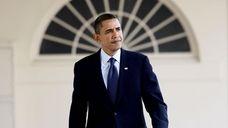 President Barack Obama walks the West Wing Colonnade