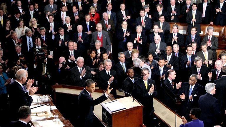 President Barack Obama waves before delivering his State
