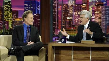 Conan O'Brien is interviewed by Jay Leno during
