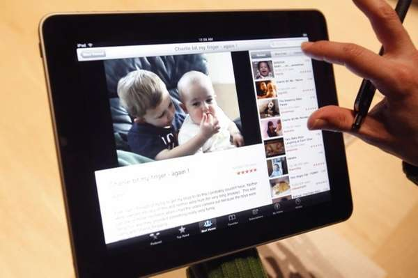 The Apple iPad is examined after its unveiling