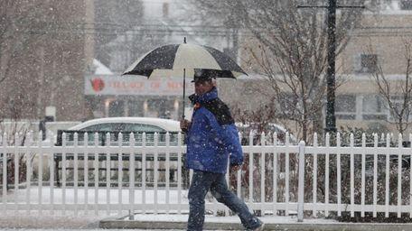 Steve Merkel makes his way down a snowy