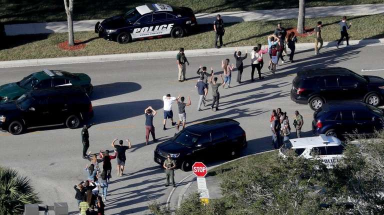 Students are evacuated from Marjory Stoneman Douglas High