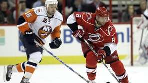 Carolina Hurricanes' Matt Cullen (8) drives the puck