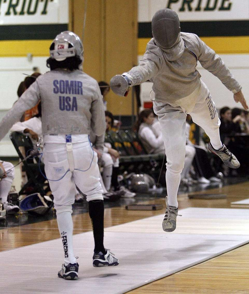 Ward Melville's Peter Freiss (r) with the leaping