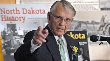 Former Gov. George Sinner gestures while reminiscing about