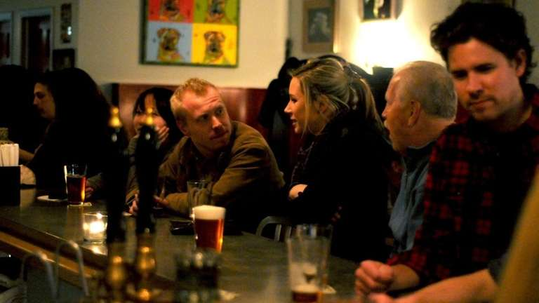The lively bar crowd drinks hand-pulled cask ales