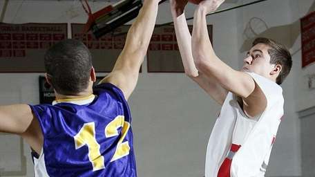 Southold's Kevin Parma (3) takes the shot from