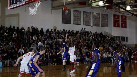 Southold's Justin Moore (21) shoots a three-pointer in