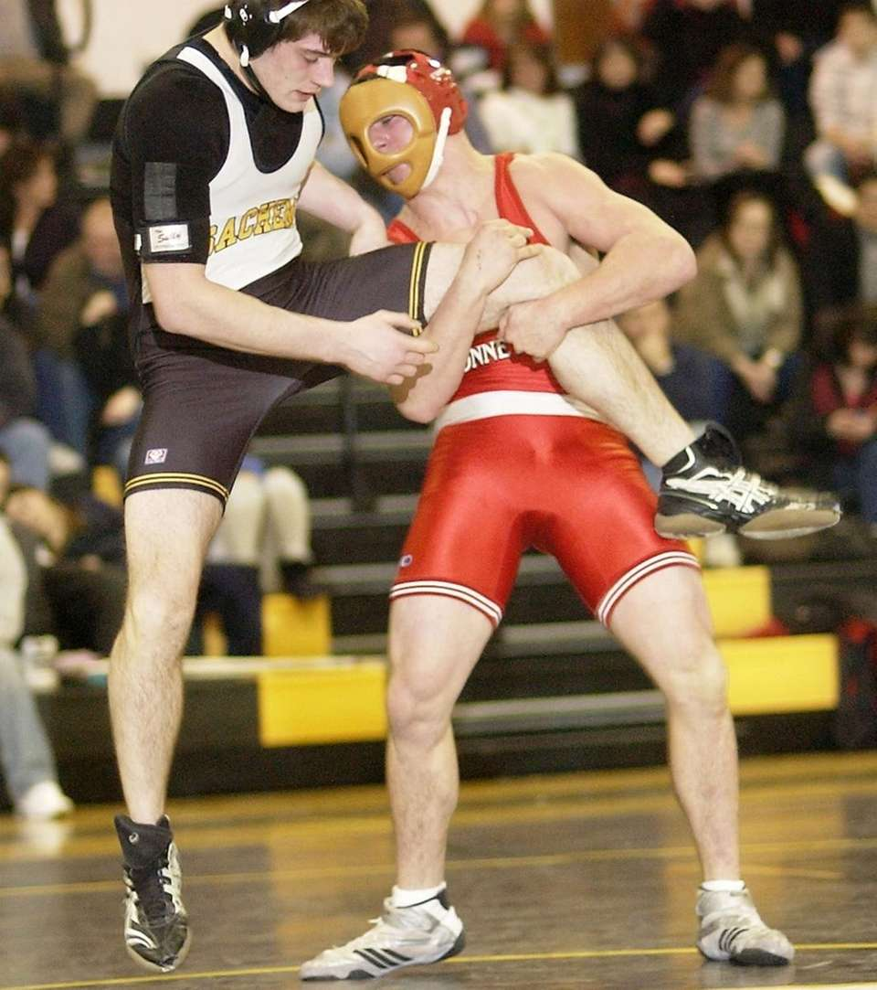 Connetquot's John Zullo (right), works on Sachem's Billy