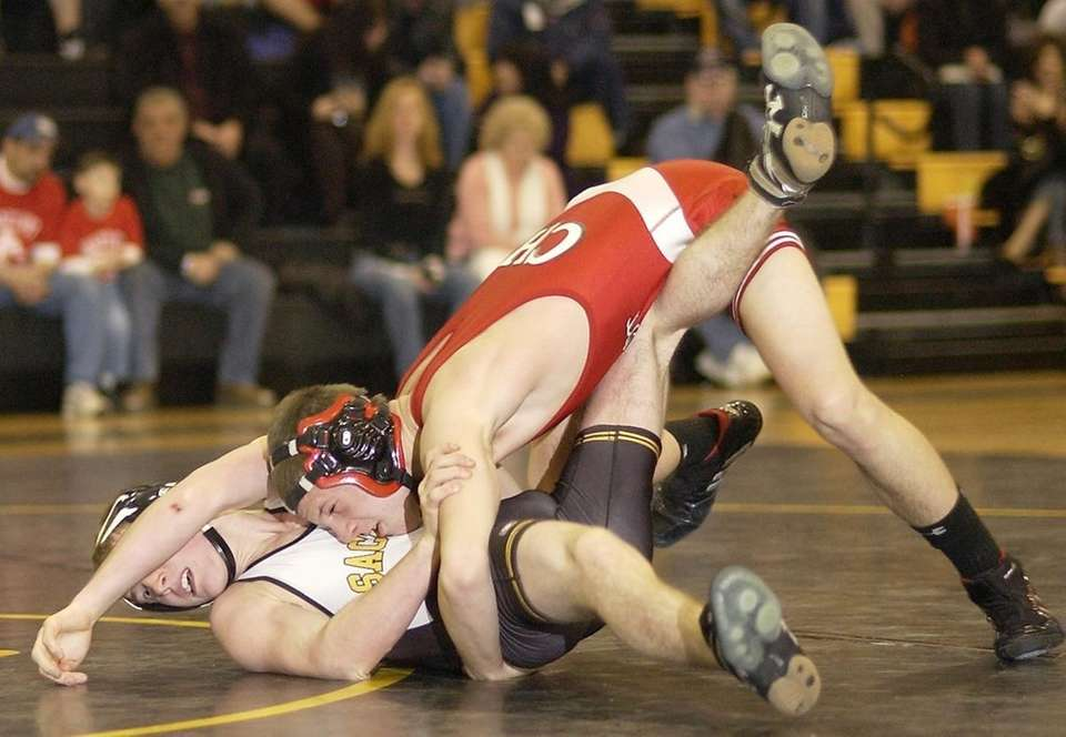 Connequot's Mike Cella (right, top), works on Sachem's
