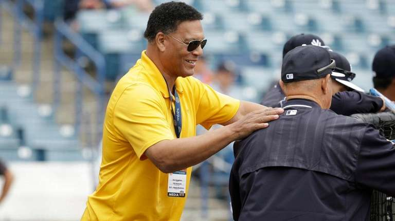 Yankees analyst Ken Singleton, left, watch batting practice