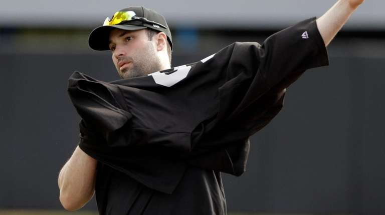 Neil Walker puts on his jersey before a