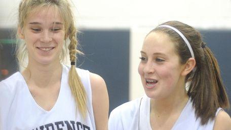 Lawrence Woodmere Academy teammates #11 Caroline Clark, left,