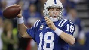 Indianapolis Colts quarterback Peyton Manning passes during the