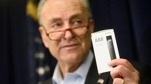 Sen. Chuck Schumer holds a Juul, a type