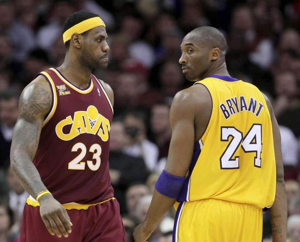 Cleveland Cavaliers' LeBron James (23) and Los Angeles