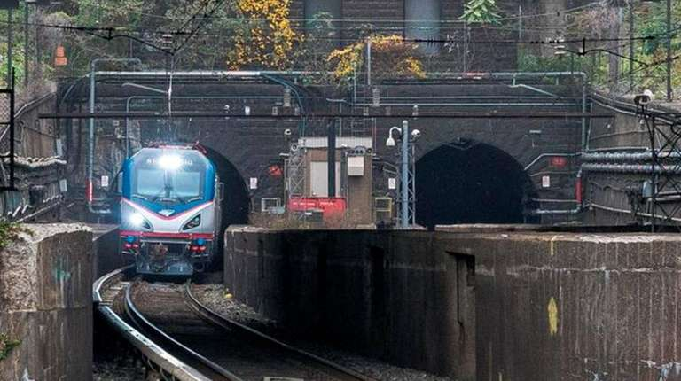 An Amtrak locomotive emerges from the existing Hudson