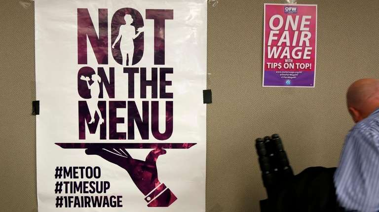 Signs supporting fair wages and treatment are displayed