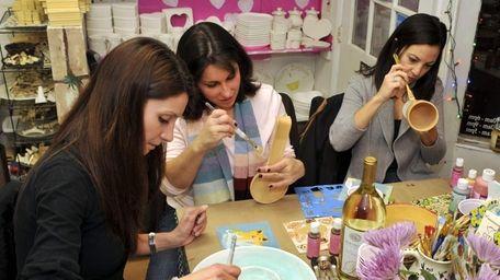 Valerie Santeramo, Danielle Ardito and Tricia Scarlata gather