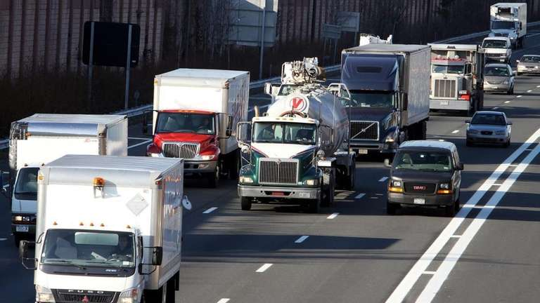Trucks head east on the LIE near exit