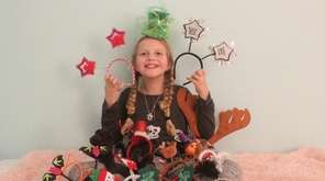 Kidsday reporter Alivia Saunders with her headband collection,
