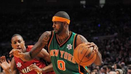 Knicks guard Larry Hughes (0) controls the basket