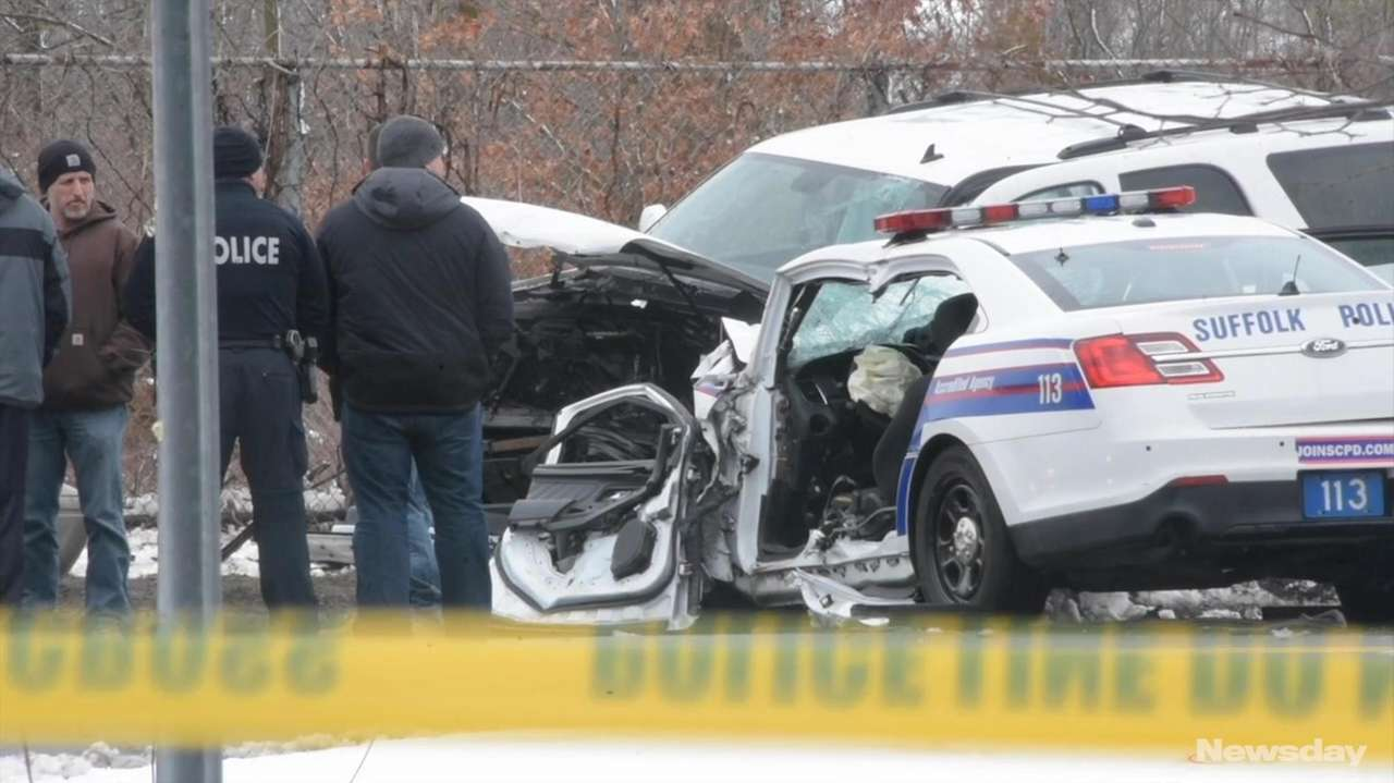 Suffolk County officials discuss a collision on Tuesday, March