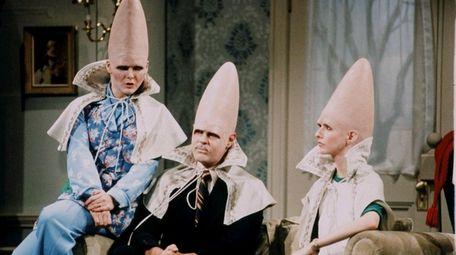 The Conehead family -- Jane Curtin, left, Dan