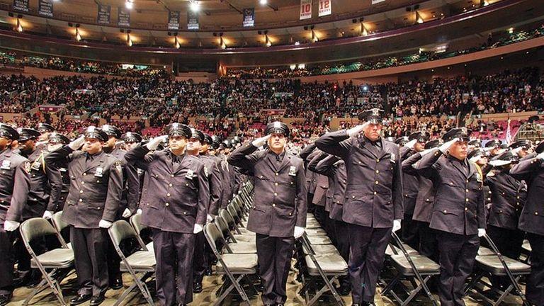 New York City Police Academy graduates salute as