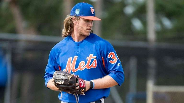 Mets pitcher Noah Syndergaard throws during a spring