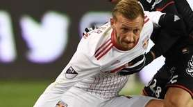 The Red Bulls' Danny Royerkeeps the ball from