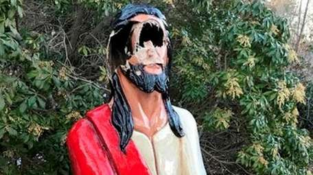 The damage to the statue of Jesus at