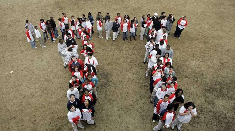 Students make a human Pi symbol during a