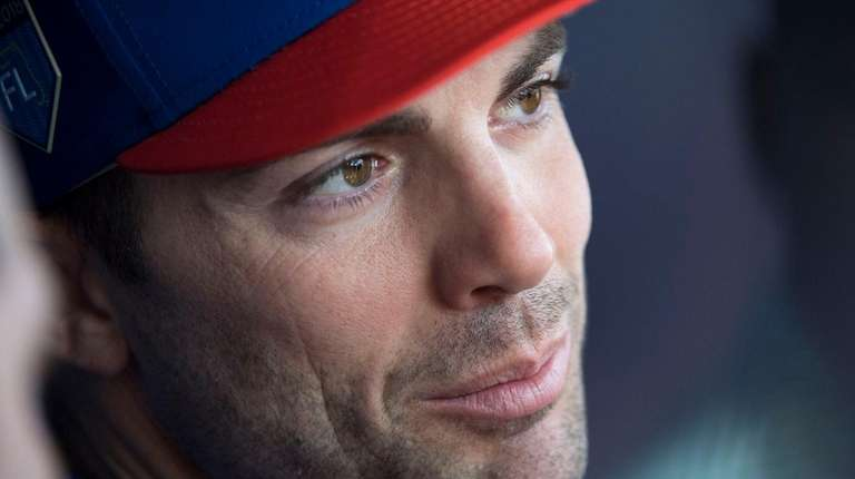 Mets captain David Wright talks to reporters during