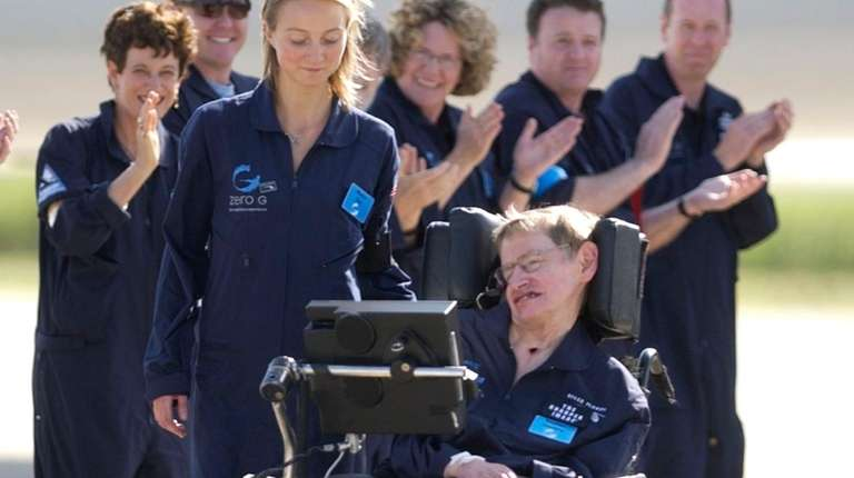 Astrophysicist Stephen Hawking is assisted off the tarmac
