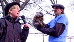 Malverne Mayor Patti McDonald, left, with groundhog 'Mel'
