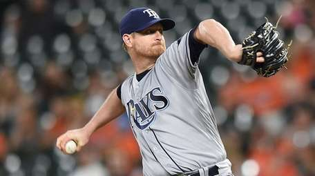 Tampa Bay Rays pitcher Alex Cobb throws against