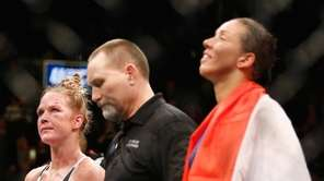 Holly Holm and Germaine de Randamie, with referee
