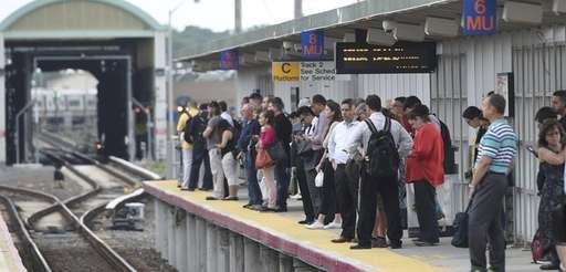 LIRR commuters at the Ronkonkoma station wait for