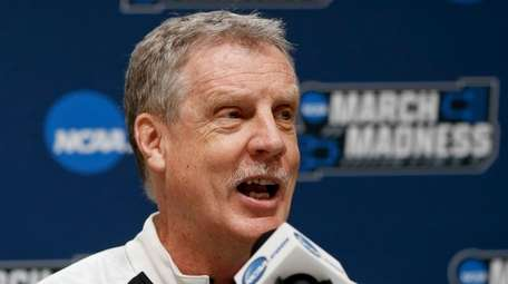 Iona's coach Tim Cluess takes questions during a