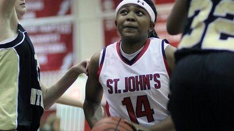 St. John the Baptist's Brianna Thomas splits the