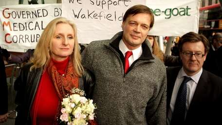 Dr. Andrew Wakefield walks with his wife after