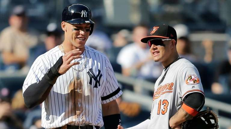Aaron Judge, left, talks with Orioles third baseman