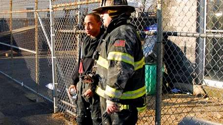 Caleb Lacey, left, with fire chief Joseph Sperber,
