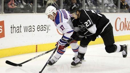 New York Rangers center Brandon Dubinsky, left, battles