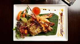 Siam shrimp, marinated and grilled, is served with