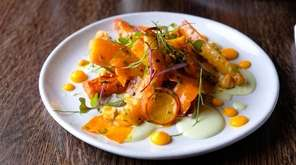 Roasted carrots with carrot puree, creamy goat cheese,