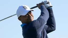 Tiger Woods tees off on the 16th hole