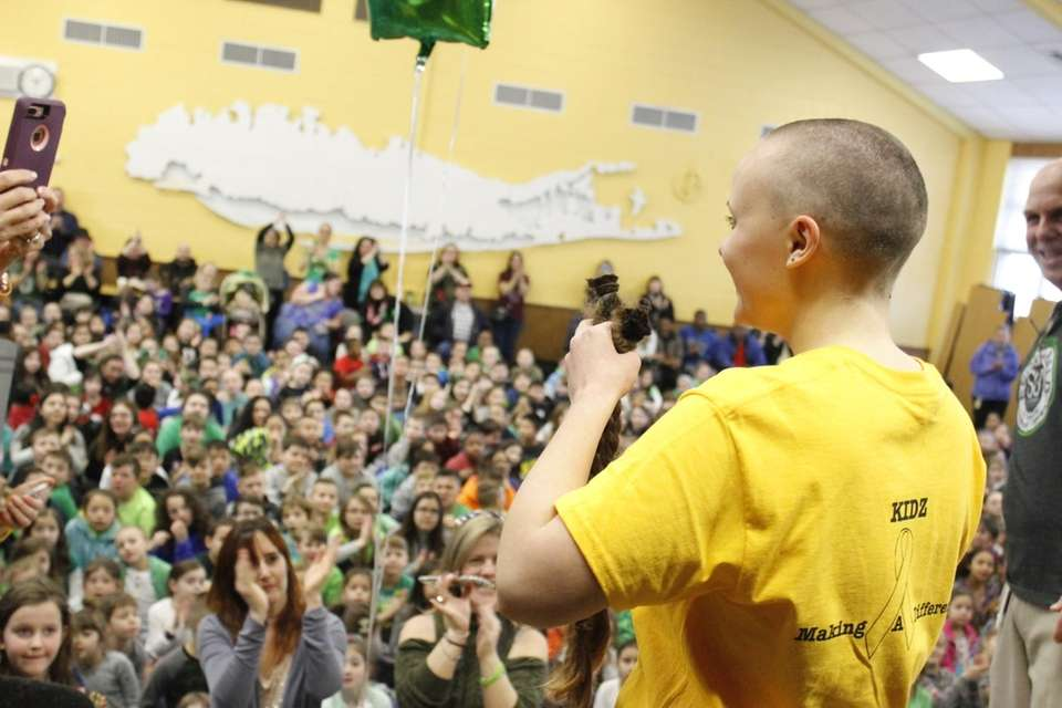 Meg Gabel, 17, got her head shaved at